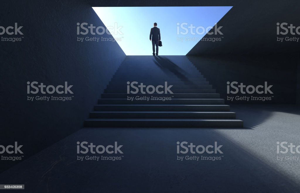 Successful businessman climbing on stair stock photo