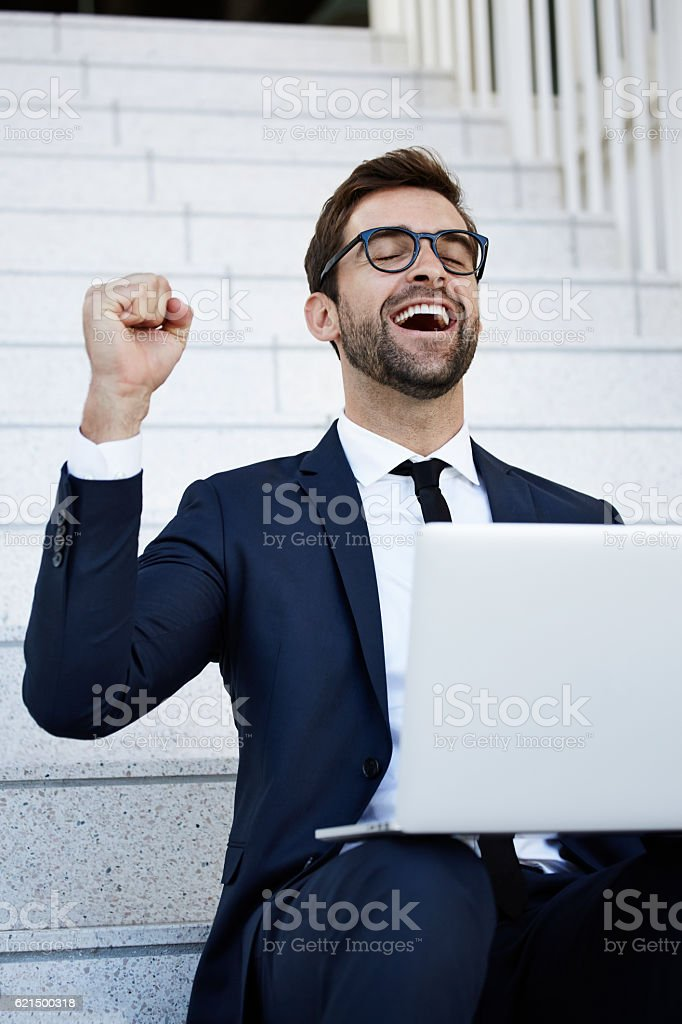 Successful businessman closing deal on steps foto stock royalty-free