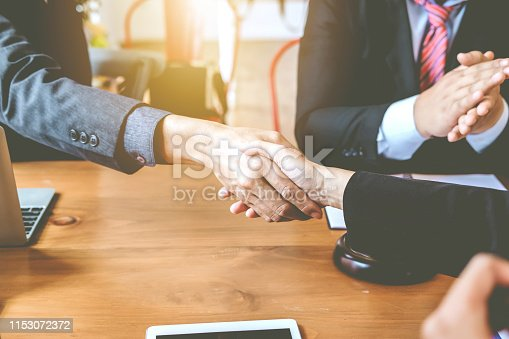 836113188 istock photo Successful businessman handshake at meeting. Congratulations and Confirmation in the agreement investment together. 1153072372