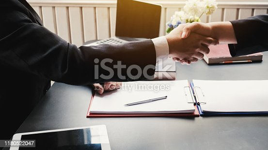 836113188 istock photo Successful businessman handshake at meeting. Congratulations and Confirmation in the agreement investment together. 1180522047