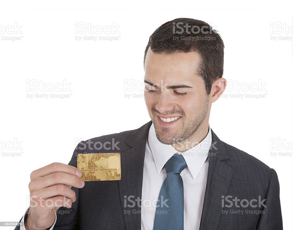 Successful businessman holding credit card royalty-free stock photo