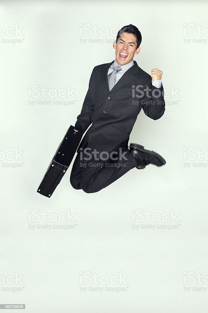 Successful businessman jumping royalty-free stock photo