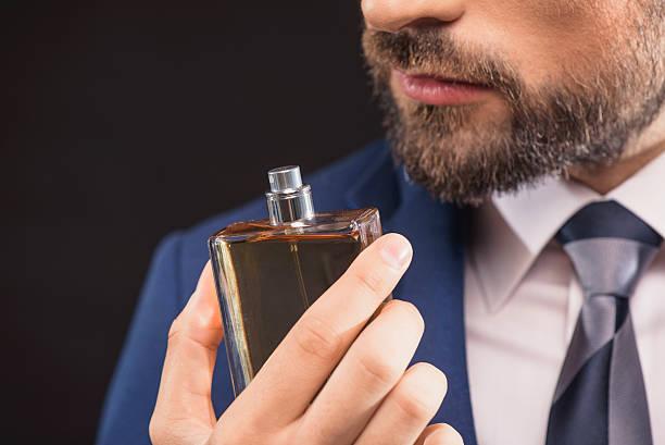 successful businessman likes perfume scent - parfym bildbanksfoton och bilder