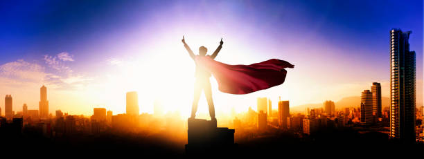 successful businessman looking to the city - super hero stock pictures, royalty-free photos & images