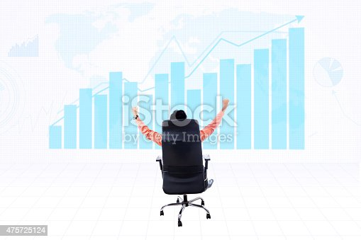 Businessman raising his arms with profit bar chart background