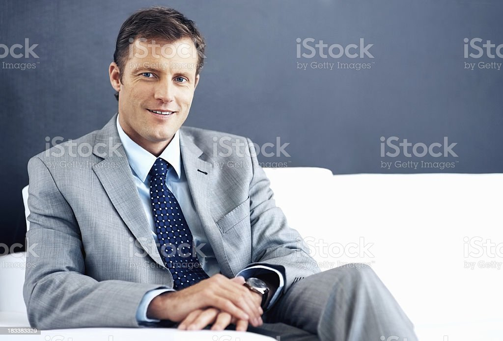 Successful businessman on sofa royalty-free stock photo