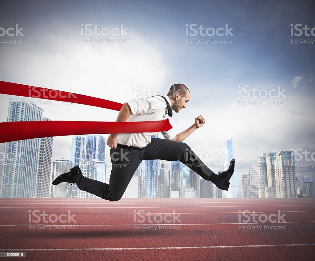 Successful businessman  on the finishing line stock photo