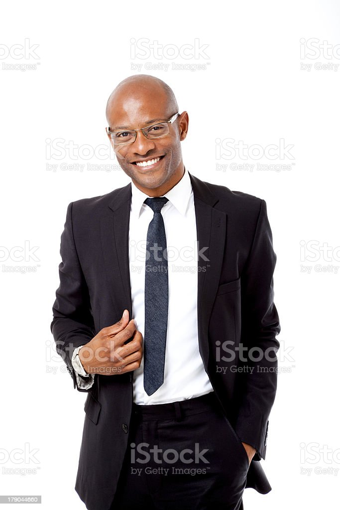 Successful businessman posing for photo in studio stock photo