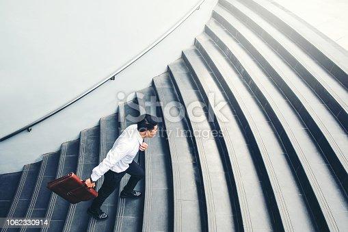 684803840istockphoto Successful businessman running fast upstairs Success concept 1062330914