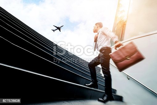 istock Successful businessman  running fast upstairs Success concept 827528608