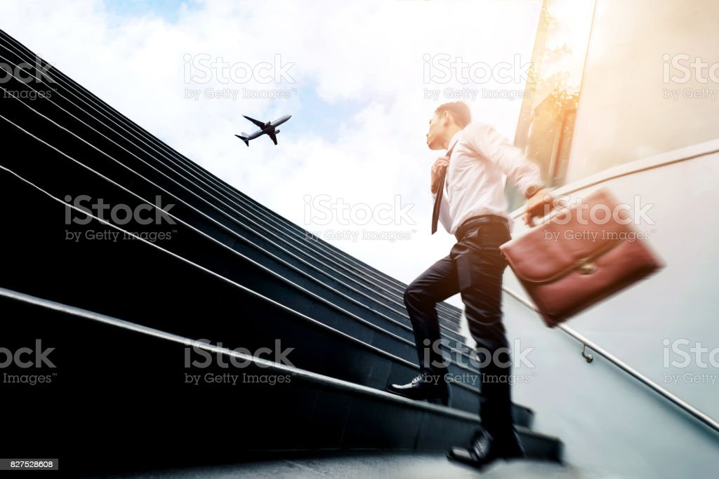 Successful businessman  running fast upstairs Success concept stock photo