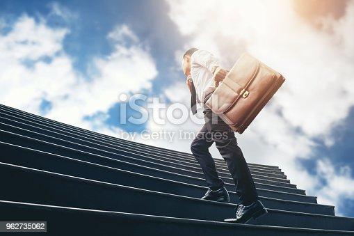 684803840istockphoto Successful businessman running fast upstairs Success concept 962735062