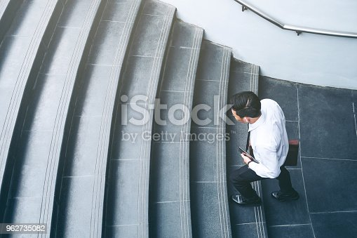 684803840istockphoto Successful businessman running fast upstairs Success concept 962735082