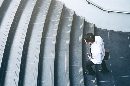 684803840 istock photo Successful businessman running fast upstairs Success concept 962735082