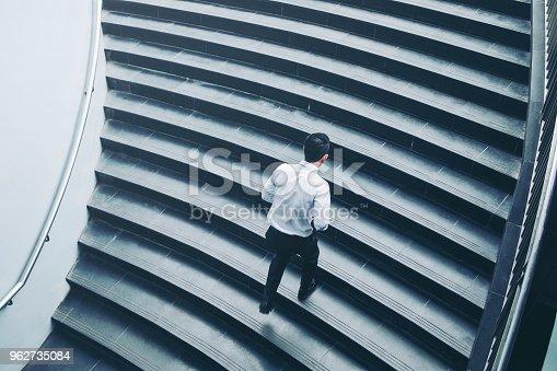 684803840istockphoto Successful businessman running fast upstairs Success concept 962735084