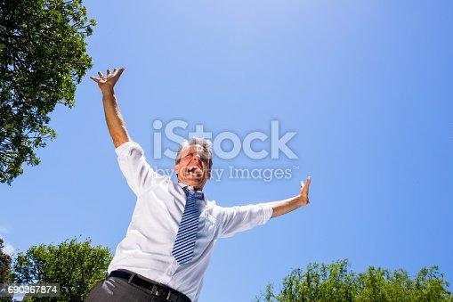 istock Successful businessman screaming 690367874