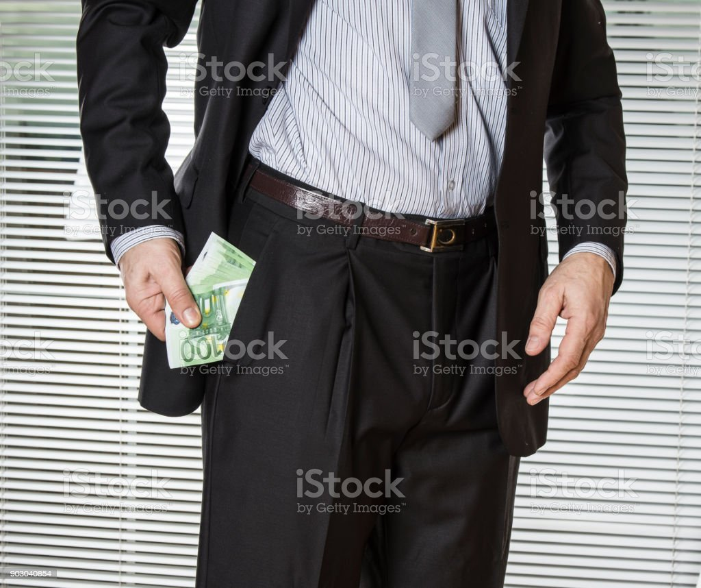 Successful businessman showing his cash money stock photo