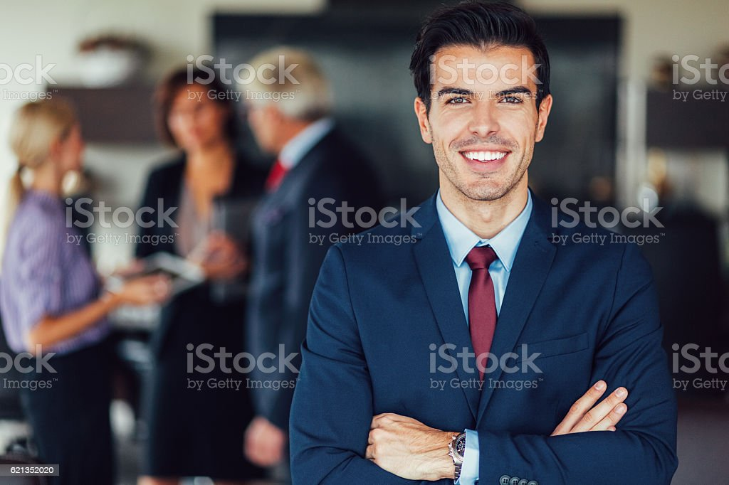 Successful businessman smiling to the camera stock photo