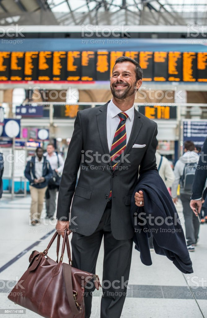Successful businessman traveling to work to financial district royalty-free stock photo