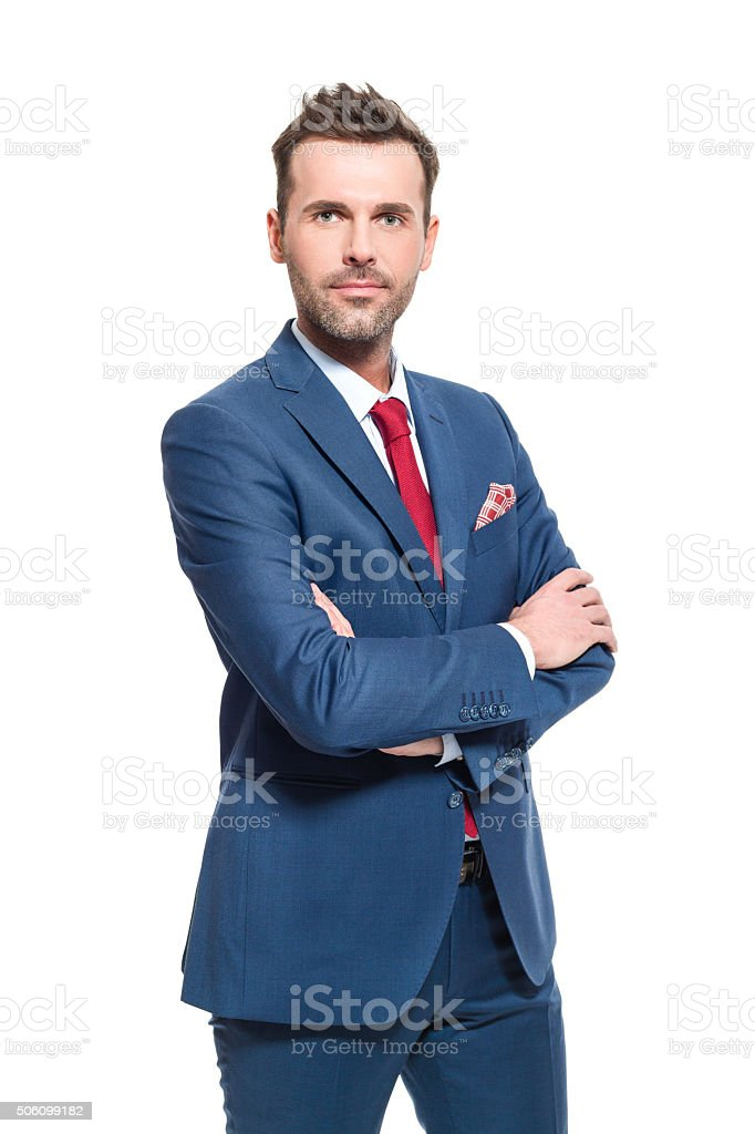 Successful businessman wearing elegant suit Portrait of elegant CEO wearing elegant suit, looking at camera. Studio shot, one person, white background. Adult Stock Photo