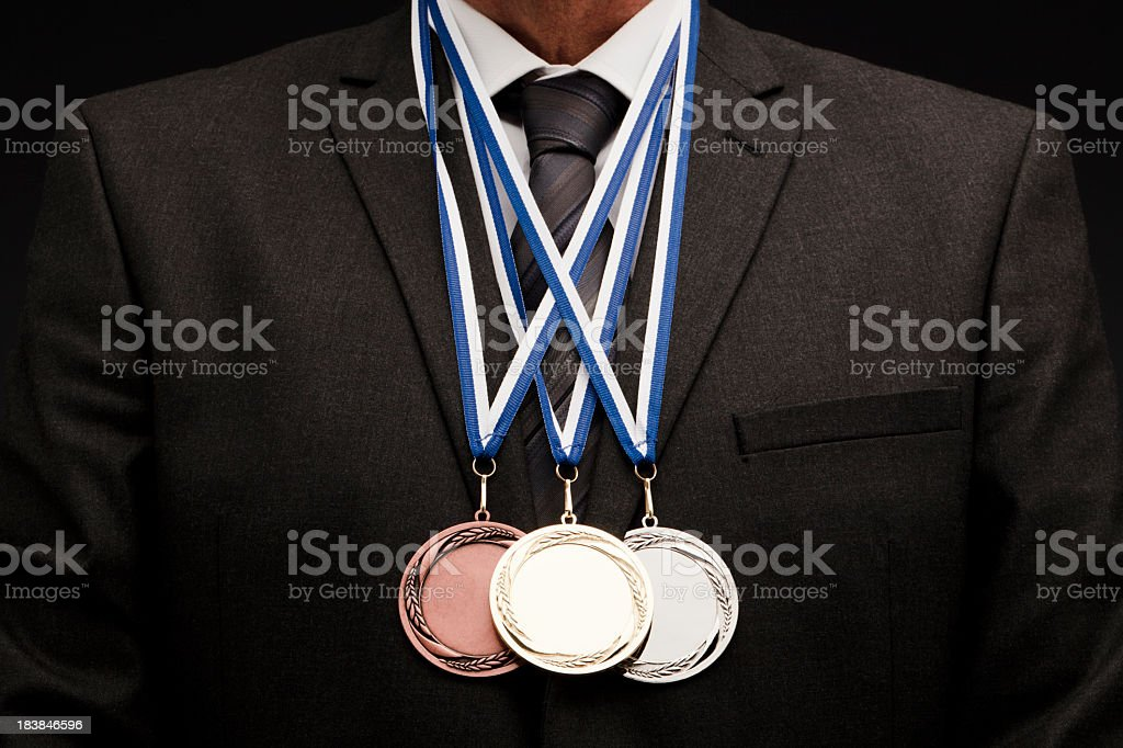 A successful businessman who won three medals stock photo
