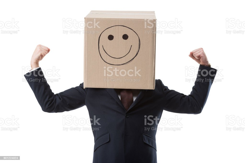 successful businessman with box with smile sign stock photo