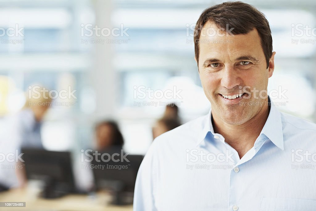 Successful  businessman with colleagues in the background royalty-free stock photo