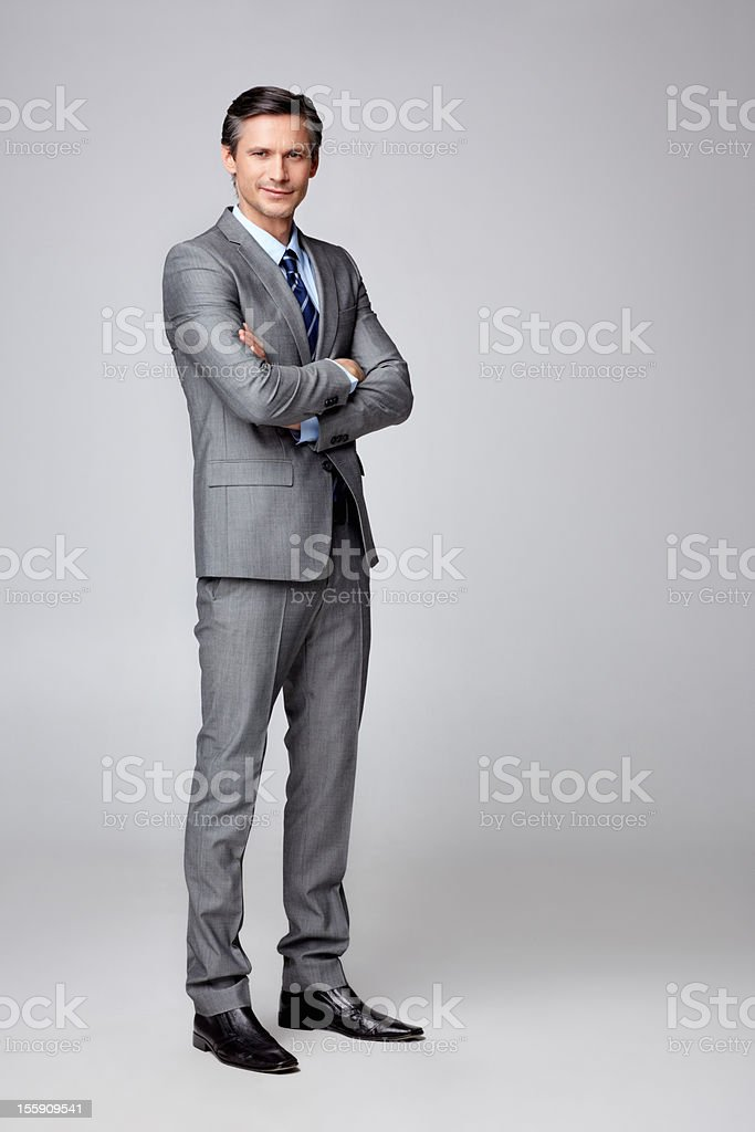 Successful businessman with hands folded - copyspace stock photo