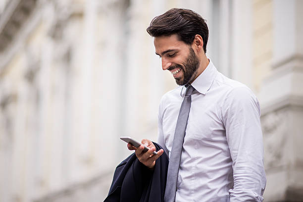 Successful businessman with mobile phone stock photo