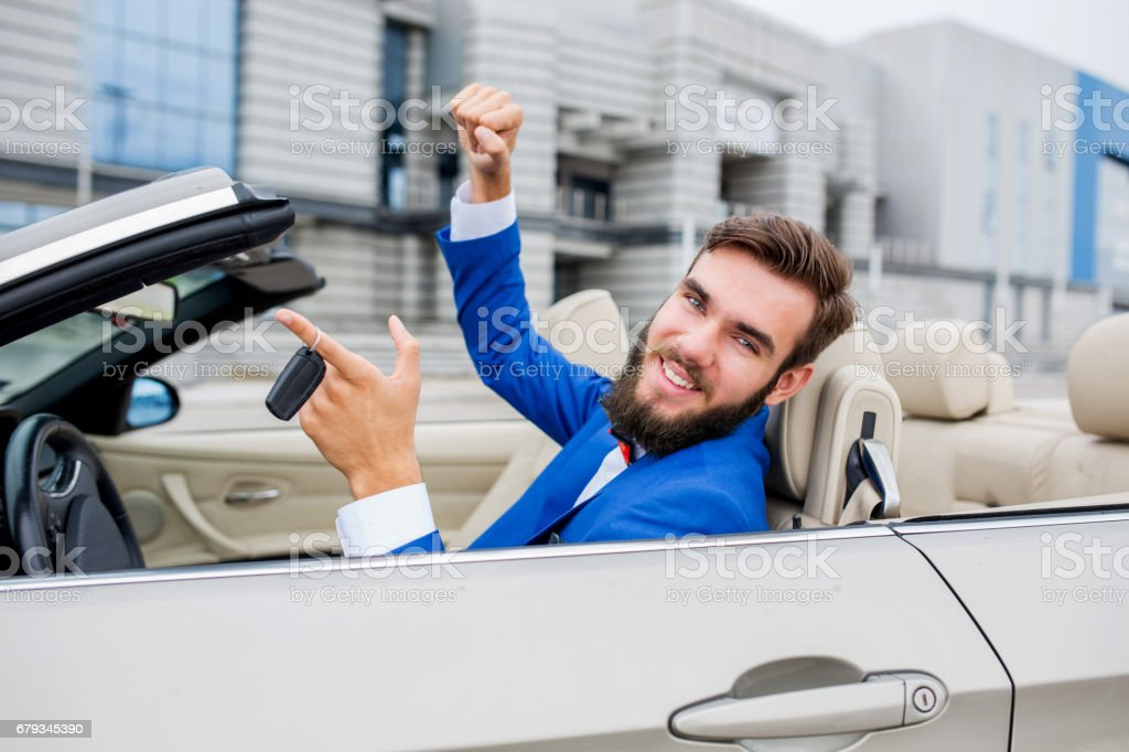 Successful businessman with new convertible car keys. royalty-free stock photo