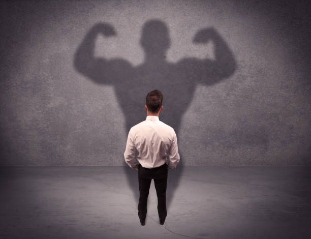Successful businessman with strong shadow stock photo