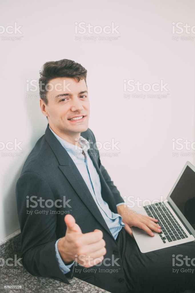 Successful businessman with thumb up_tone royalty-free stock photo
