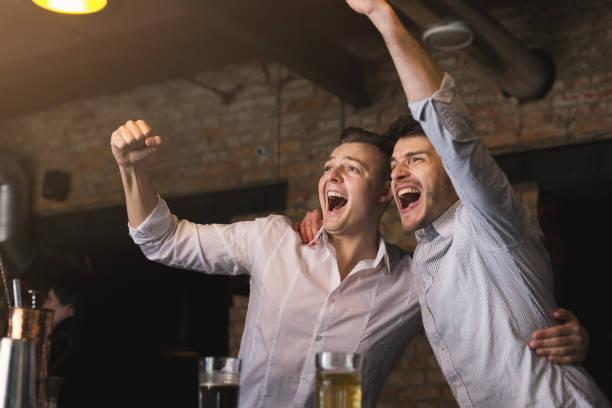 Successful businessmen drinking beer and shouting at the bar picture id964912314?b=1&k=6&m=964912314&s=612x612&w=0&h=xdueom euk1gqjvvj3qdwrtkymbkmyrytt abshlota=