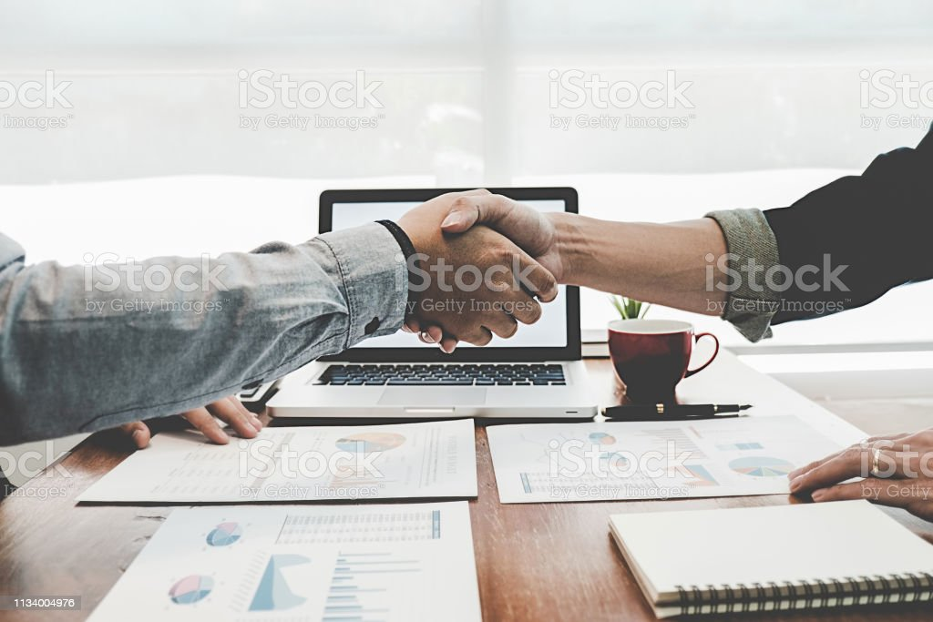 Successful businessmen handshaking after good deal. Business handshake and business people. Successful businessmen handshaking after good deal. Business handshake and business people. Adult Stock Photo