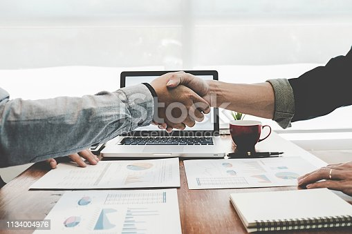 istock Successful businessmen handshaking after good deal. Business handshake and business people. 1134004976