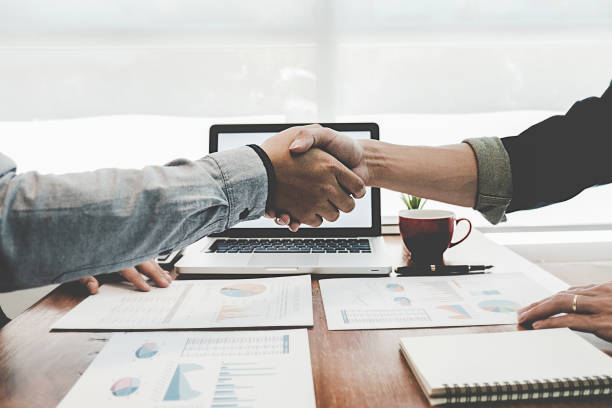 successful businessmen handshaking after good deal. business handshake and business people. - handshake stock pictures, royalty-free photos & images