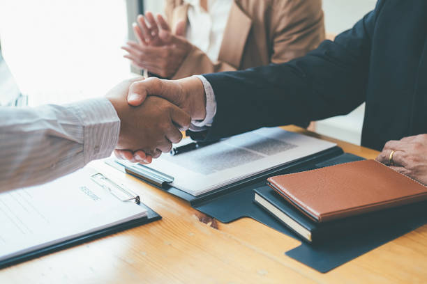 Successful businessmen handshaking after good deal. Business handshake and business people. stock photo