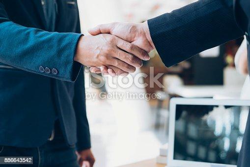 522304914 istock photo Successful businessmen handshaking after good deal. 886643542