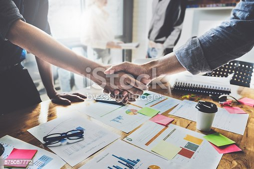 istock Successful businessmen partnership handshaking after acquisition and business working at background. Meeting for sign contracts and Group support concept. 875087772