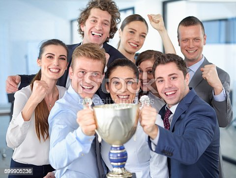 istock Successful businesspeople celebrating with the cup in hands 599905236