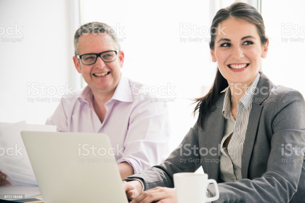 Successful Businesswoman and her Partner together in a Business Meeting stock photo