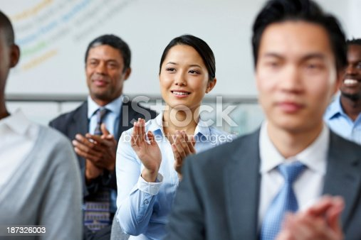 505413934 istock photo Successful businesswoman applauding at a seminar with colleagues 187326003