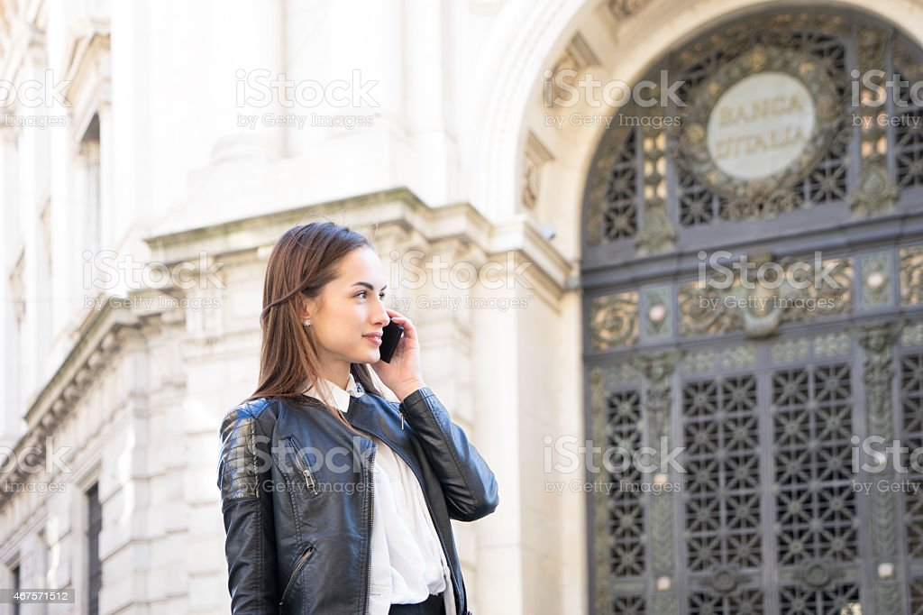 Successful Businesswoman On The Phone In Urban Landscape stock photo