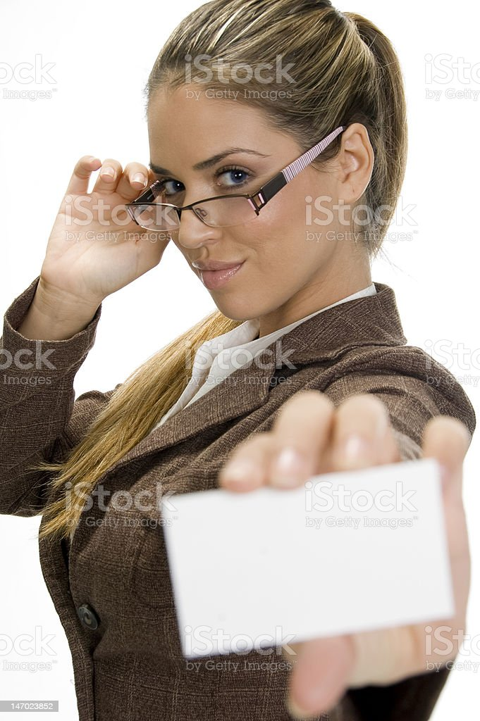 successful businesswoman posing and holding a business card royalty-free stock photo