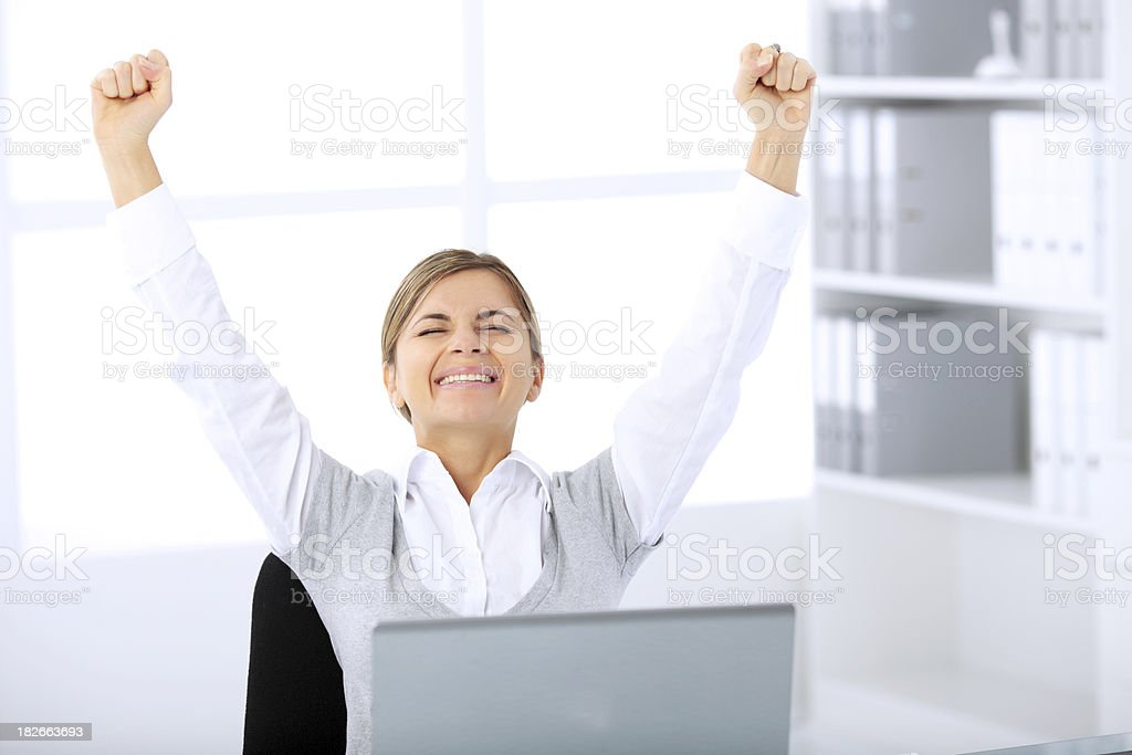 Successful businesswoman raising hands and laughing. royalty-free stock photo