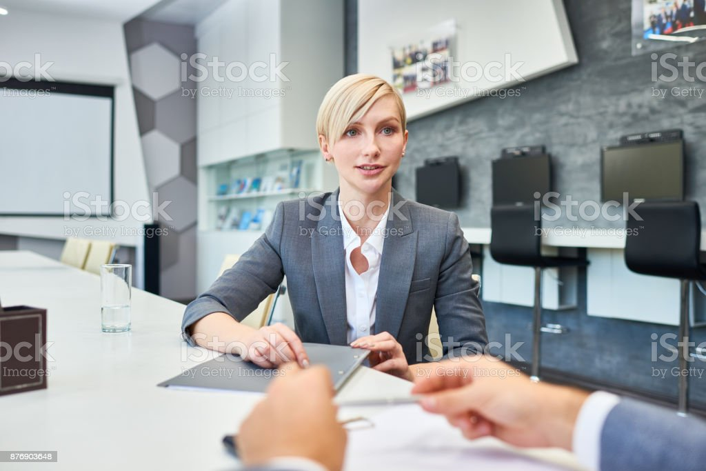 Successful Businesswoman Talking to Partners stock photo
