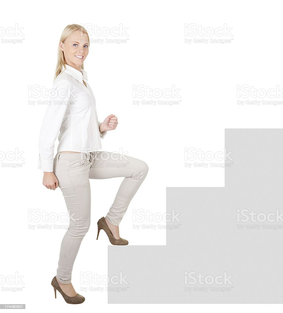 Successful businesswoman walking up a staircase royalty-free stock photo