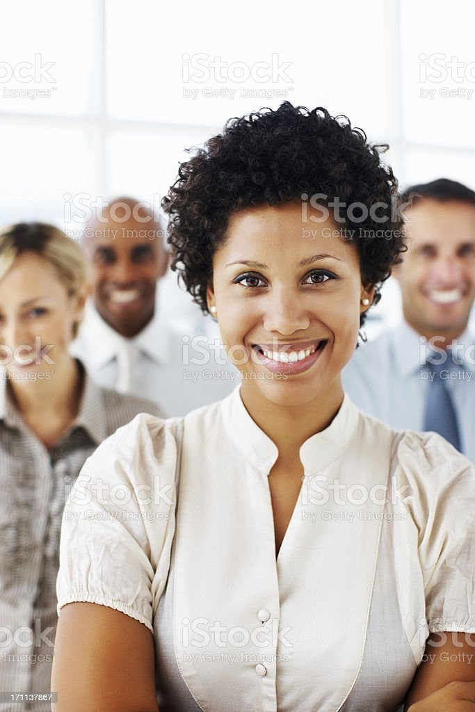 Successful businesswoman with colleagues in the background royalty-free stock photo
