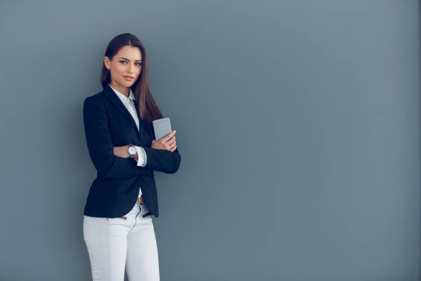Successful businesswoman with mobile phone stock photo