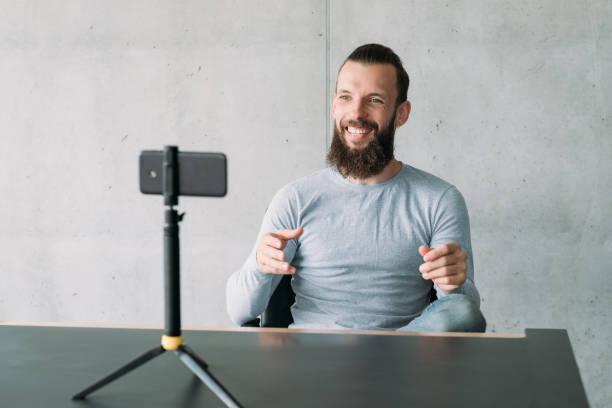 successful career training guy smartphone camera stock photo